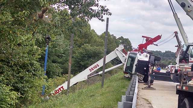 A crane used to post a sign overturned Wednesday, leading to the complete closure of Interstate 40 west.