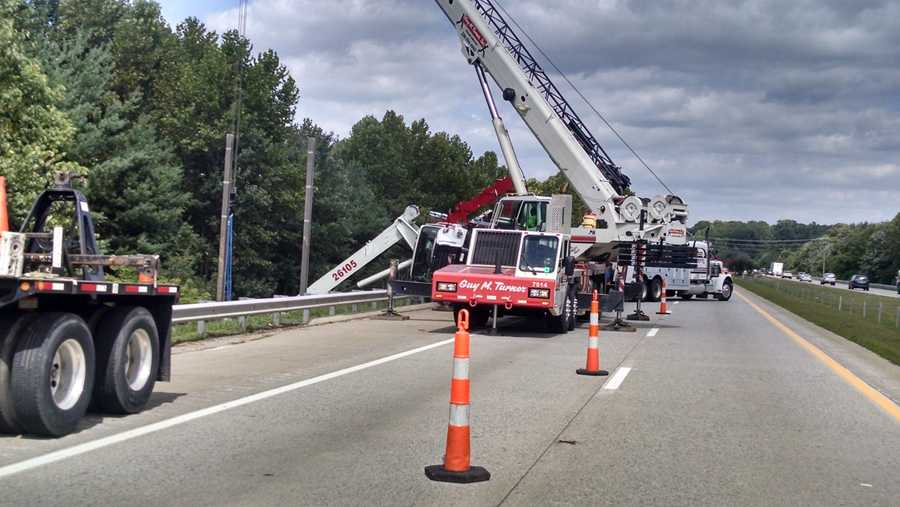 The truck was being used to put up a new road sign when the boom was extended too far, causing the vehicle to turn on its side, emergency officials at the scene said.