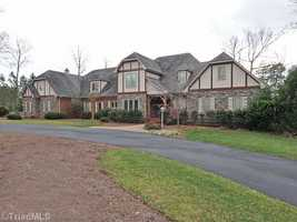 This gated Lewisville home is situated on over 2 acres and priced at $1,000,000.