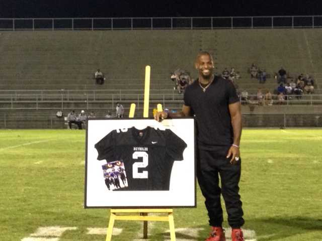 Anthony Levine has his RJ Reynolds Jersey Retired
