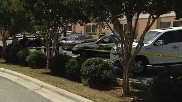 Body found in parking lot of Holiday Inn Express in Greensboro