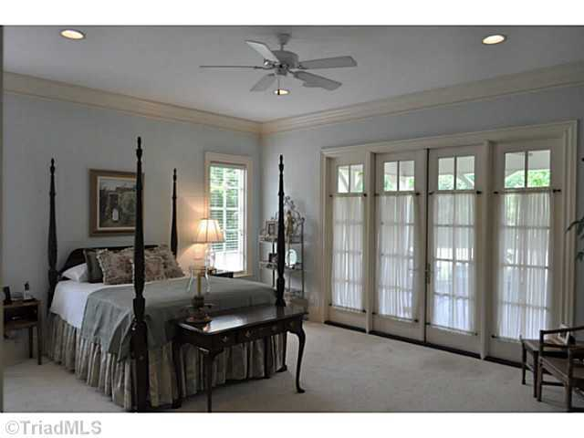 Master Suite with french doors leading to the covered porch