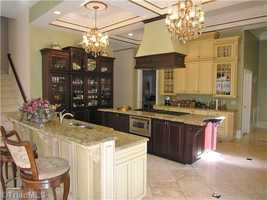 Epicurean Kitchen with eat-in bar area