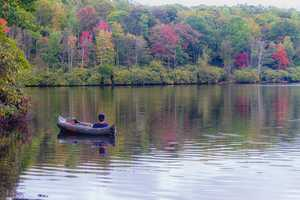Sept. 28: A fisherman enjoys the stillness of Price Lake, located on the Blue Ridge Parkway near Blowing Rock, where the water is beginning to reflect the changing leaves of autumn. (Photo by Monty Combs)