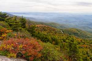 Sept. 29: Stack Rock: The view from Grandfather Mountain's Linville Peak shows bursts of vibrant color appearing near the Stack Rock Parking Area on the Blue Ridge Parkway. (Photo by Monty Combs)