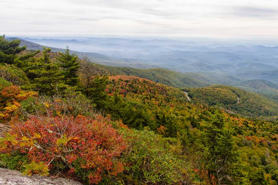 Sept. 29:Stack Rock: The view from Grandfather Mountain's Linville Peak showsbursts of vibrant color appearing near the Stack Rock Parking Area on theBlue Ridge Parkway. (Photo by Monty Combs)