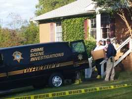 On Monday, Oct. 6, Forsyth County sheriff's investigators hauled boxes out of the home on Knob Hill Drive.