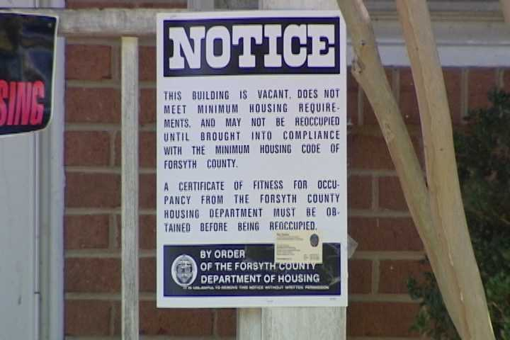 A sign displayed outside the home Wednesday.