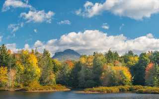 Oct. 9: Fall colors dance on the edge of the lake at Camp Yonahnoka, just south of Grandfather Mountain in Linville. (Photo by Skip Sickler)