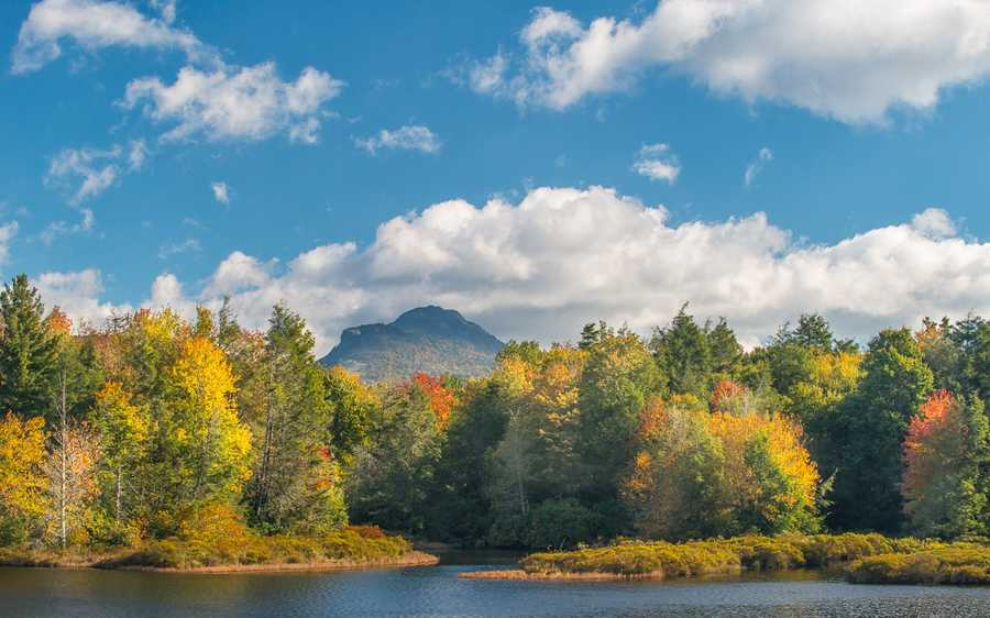 Oct. 9: Fall colors dance on the edge of the lake at Camp Yonahnoka, just south ofGrandfather Mountain in Linville. (Photo by Skip Sickler)