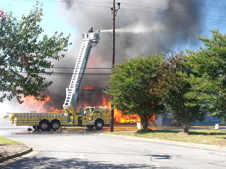 Firefighters battled a large fire at a Rockingham County auto garage Thursday. The fire was reported around 1 p.m. Thursday at JDK Automotive at 309 N. Highway St. in Madison.