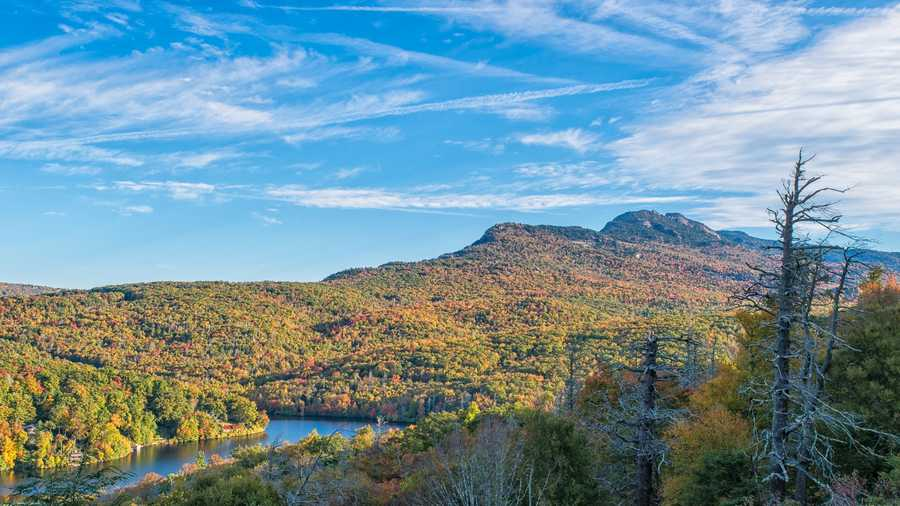 Oct. 10: While fall color is reaching peak on the high-elevation ridges ofGrandfather Mountain, the lower elevations around Grandfather Lake provethat they still need several more days to mature. (Photo by Skip Sickler)