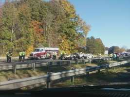 The tractor-trailer hit the sixth vehicle involved, a 2004 Honda, before coming to rest on the guardrail.