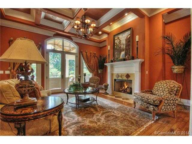 This room has a beautiful coffered ceiling and one of three fireplaces located in the home