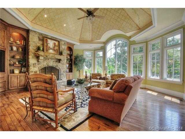 This room has beautiful built-ins and also one of three fireplaces located in the home