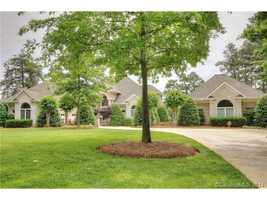 This four bedroom lakefront property is located in Mooresville and priced at $1,679,000.