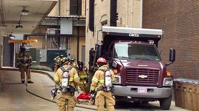 Fire crews work to contain a gas leak in downtown Greensboro.