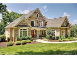 This lake front property is located in Mooresville and priced at $1,199,000.