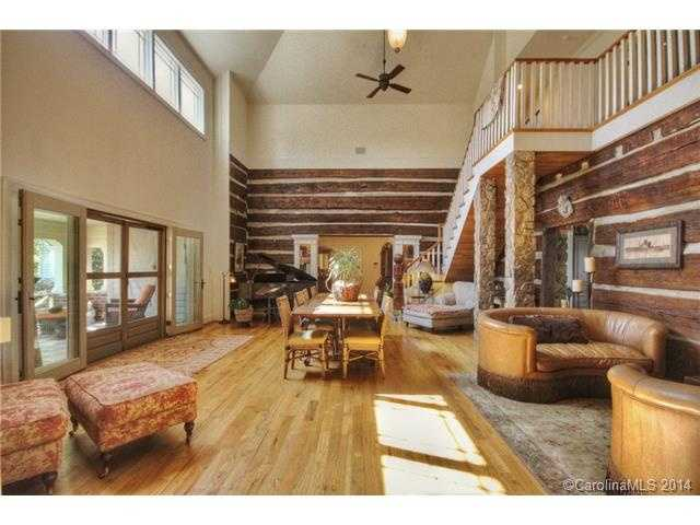 This home features original logs and chinking from the 1700s as well as this two story room with a vaulted ceiling.