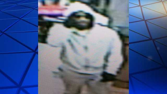 Surveillance image of Walmart MoneyCenter robbery suspect