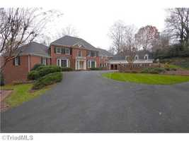 The private drive welcomes you to this Winston Salem estate situated on over 6 acres