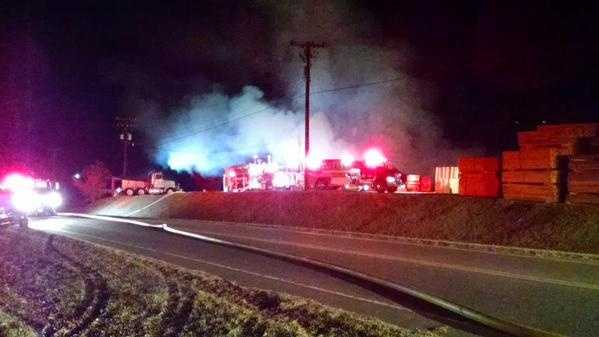 Highway 89 in Mount Airy is closed while firefighters battle a fire at Mountain Lumber & Pallet Company.