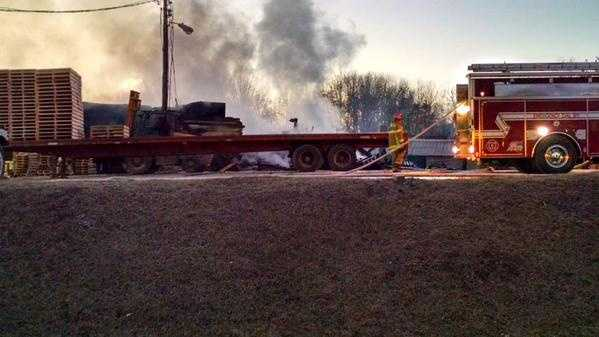 Crews were still putting out hot spots at 7:45 a.m.