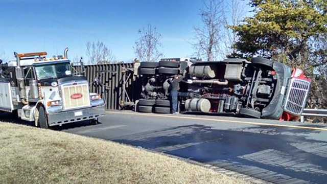 A tractor-trailer overturned on a ramp from Highway 220 north to Business 85 south in Greensboro Friday morning.
