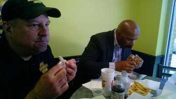 "Steve Harvey enjoys the ""Harvey Burger"" created just for him at Big Burger Spot in Greensboro."