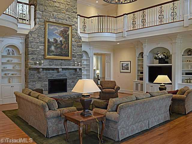 Two-story Great Room with floor to ceiling stone fireplace