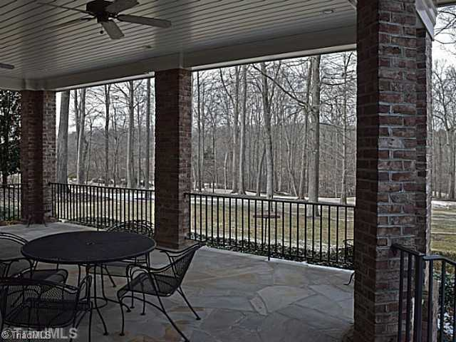 Large covered Terrace overlooks the backyard and Grandover Golf Course