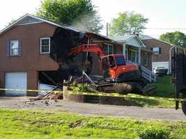 Another photo of the house being destroyed.