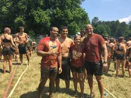 Chris and Lanie take a photo with a couple of mud run friends.