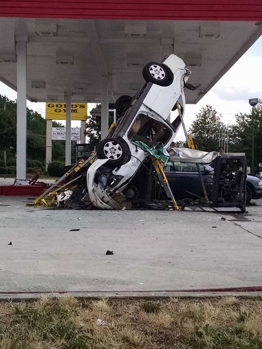 The crash was reported around 1:10 p.m. at the Kwik Buy at 3104 Randleman Road.