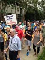 A diverse crowd marching during Moral Monday