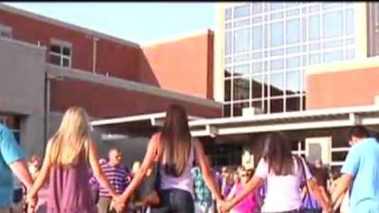 Hundreds of students at Stuart Cramer High School gathered for a prayer vigil Sunday.