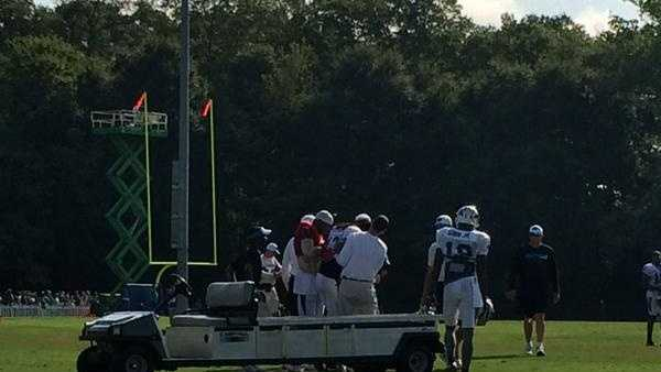 Panthers wide receiver Kelvin Benjamin is carted off the field Wednesday morning after suffering a leg injury.