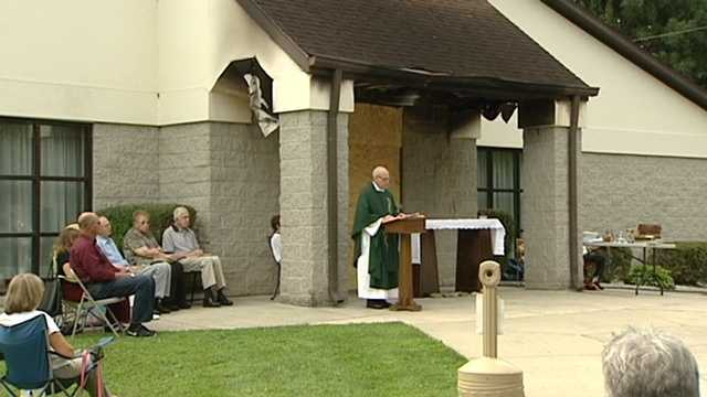 A fire moved Sunday mass outside at Holy Angels Catholic Church in Mount Airy.