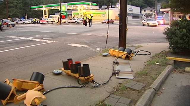 A pole carrying a pedestrian signal, just out of the picture in the top left, also was knocked down in the crash.