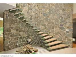 Foyer with cable curved staircase