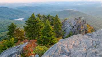 Sept. 23: Fall color peeks through at Linville Peak, just across Grandfather Mountain's Mile High Swinging Bridge. Linville Peak sits at 5,295 feet above sea level, offering visitors a spectacular vista of autumn in the High Country.