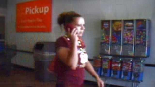 Surveillance image of purse theft suspect at Martinsville Walmart