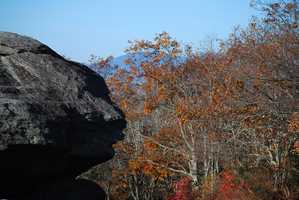 Oct. 23: The iconic Sphinx Rock keeps an autumn vigil on Grandfather Mountain. Although the peak has passed at higher elevations, Grandfather still boasts a considerable amount of spot color.