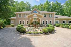 This custom built Lewisville estate is priced at $1,195,000. With over 7000 square feet, the home is situated on over 2 acres.