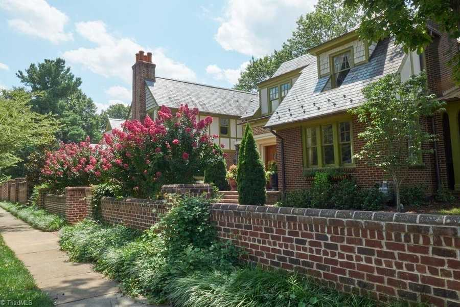 This classic Tudor estate is located in the historic Buena Vista area of Winston-Salem and is priced at $1,425,000.