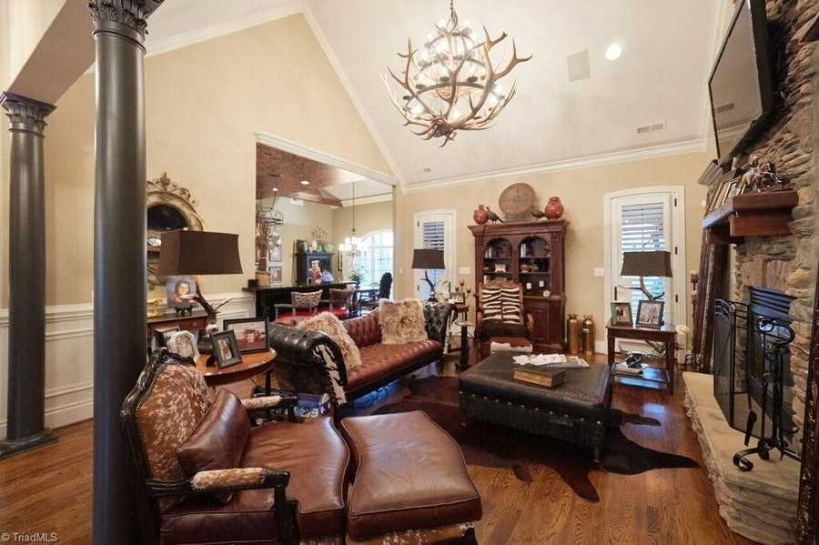 Great Room with a stone fireplace and cathedral ceiling
