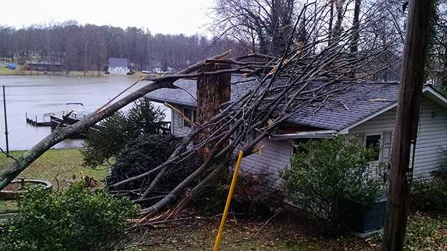 A tree fell on a house on Hickory Point Drive along High Rock Lake.