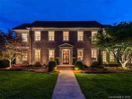 This six bedroom Charlotte estate is priced at $2,399,000. The home includes a wine cellar, pub and private guest quarters.