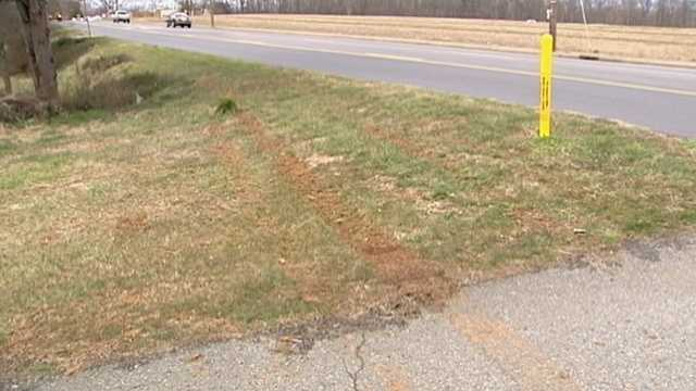Skid marks remain in muddy grass after a student was hit by a vehicle while waiting for a Dobson school bus Thursday morning.
