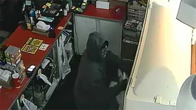 Surveillance image of wanted suspect in large theft of cigarettes from Madison convenience store